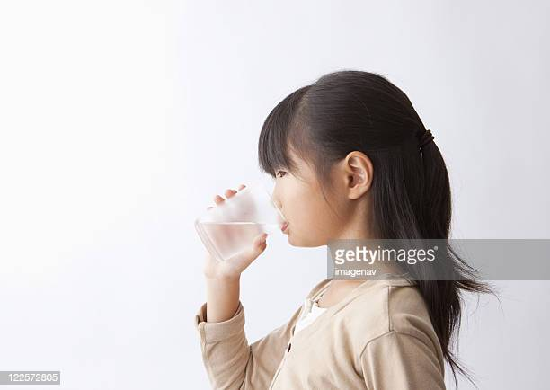 A girl drinking water