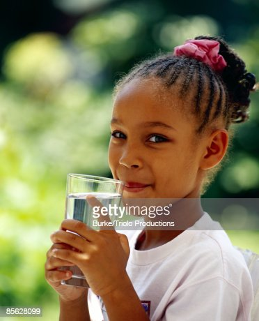 Girl drinking water : Stock Photo