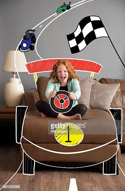 Girl driving cartoon race car