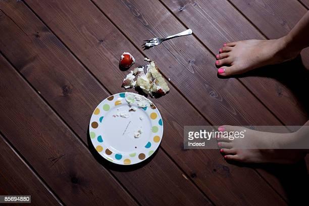 Girl dropping cake on floor