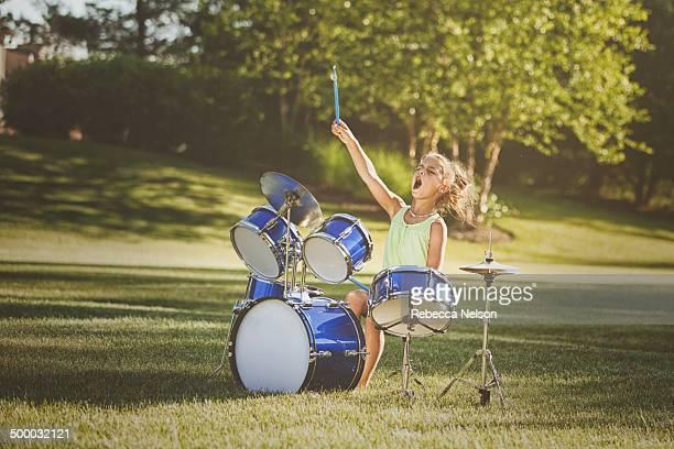 Girl drumming with wild abandon