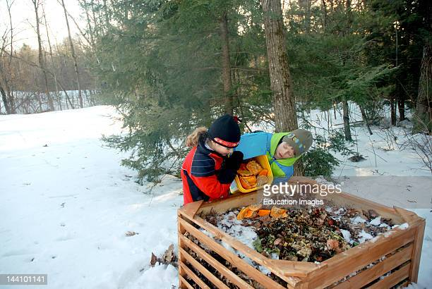 Girl Dumping Food Scraps Into Compost Bin