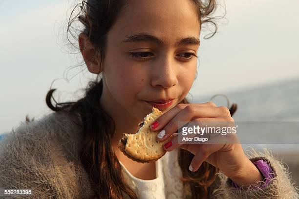 Girl eating a chocolate cookie