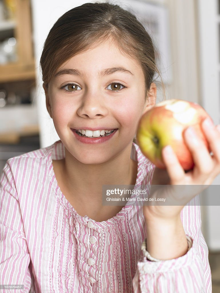 Girl eating an apple : Stock Photo