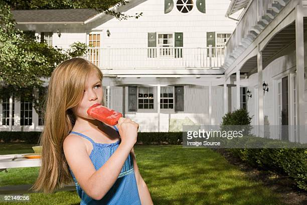 Girl eating an ice lolly