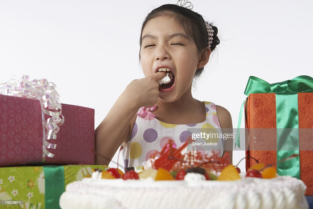 Girl Eating Birthday Cake Stock Photo Getty Images