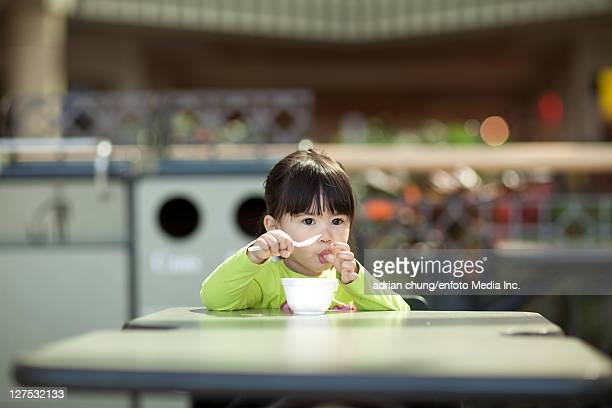 Girl eating bowl of ice cream