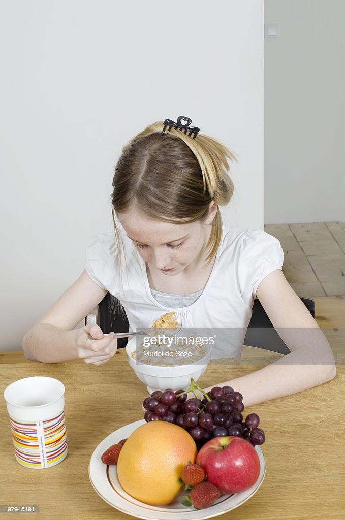 Girl eating cereals  : Stock Photo