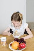 Girl eating cereals
