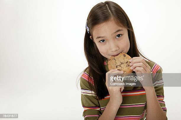 Girl eating cookie
