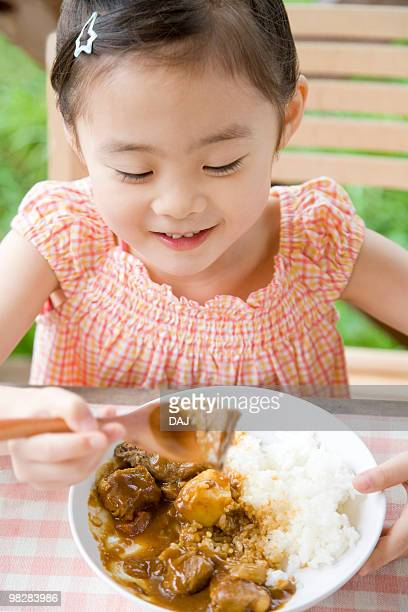 Girl eating curry