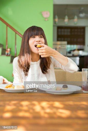 Girl eating dessert at home