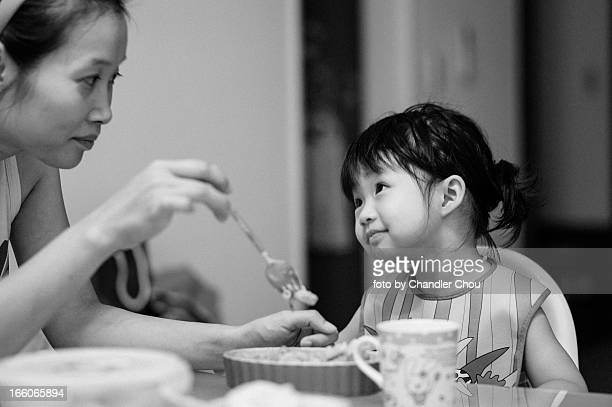 girl eating dinner with her mom