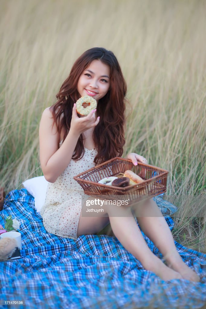 A girl eating Donut - Outdoor Picnic : Stock Photo