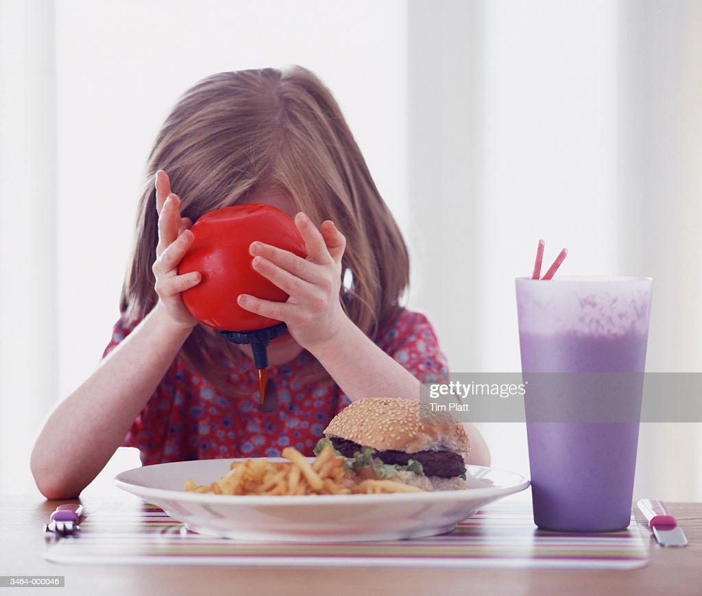 Girl Eating Hamburger : Stock Photo