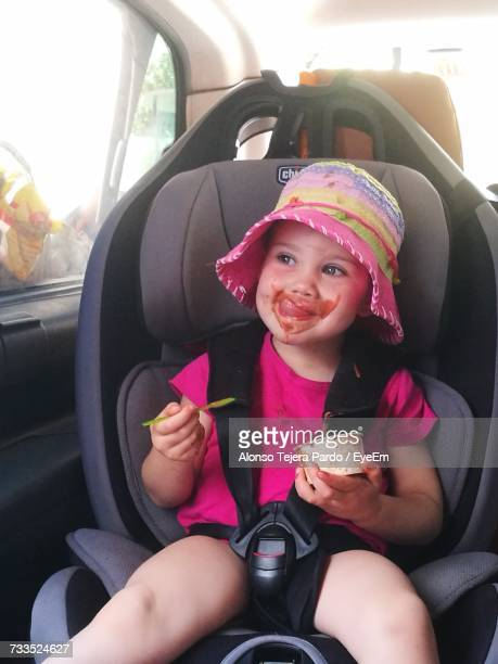 Girl Eating Ice Cream While Sitting In Car