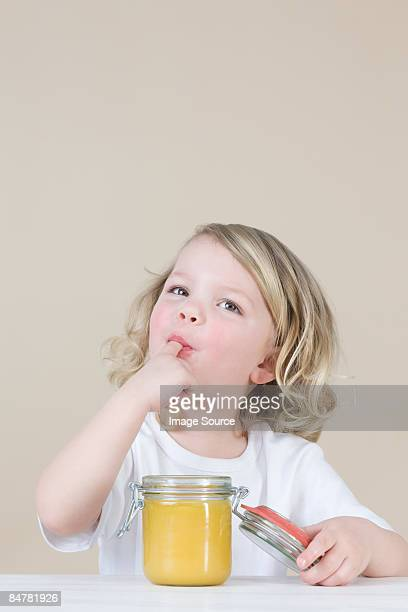 Girl eating lemon curd