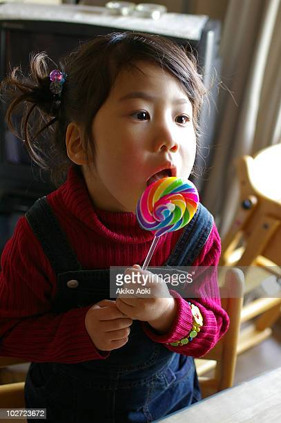 Girl eating lollipop, close-up