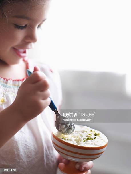 Girl Eating Rice Pudding