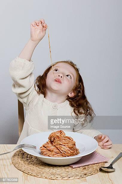 Girl eating spaghetti bolognese