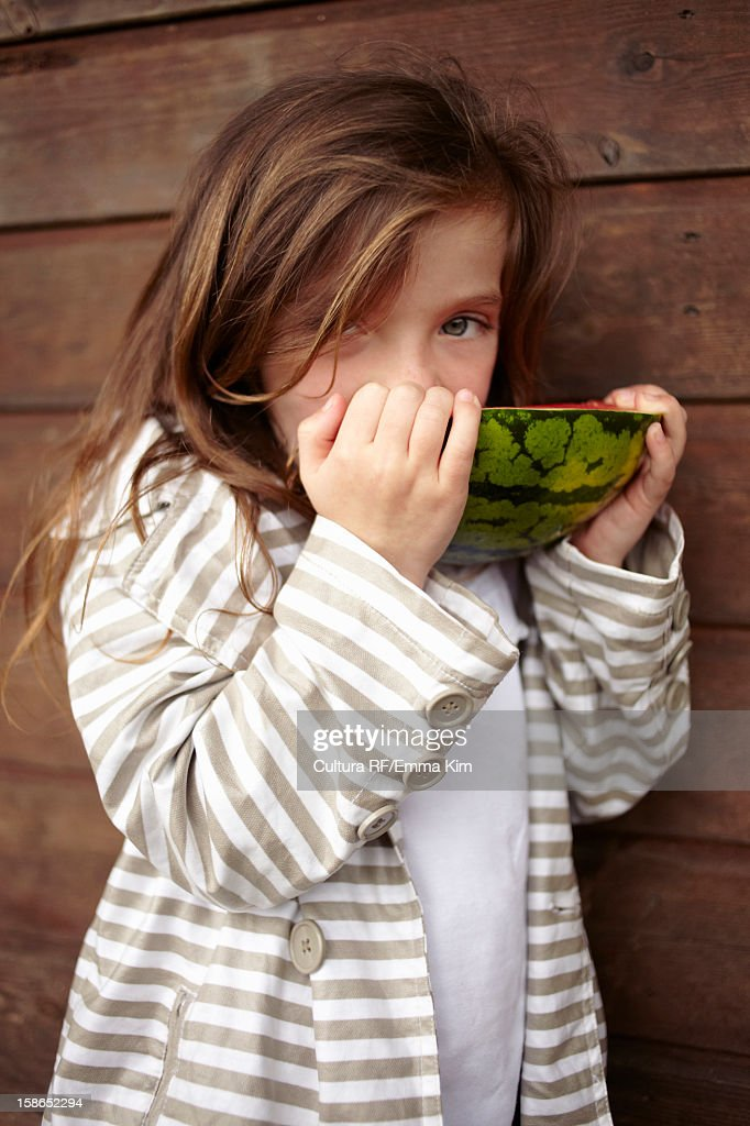 Girl eating watermelon outdoors : Stock Photo