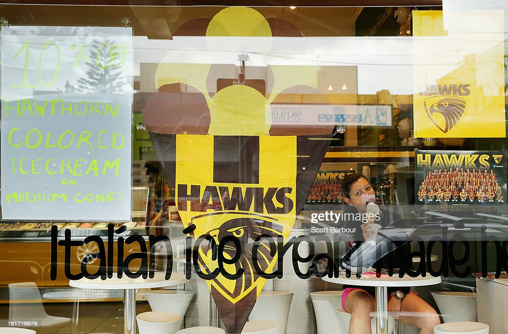 A girl eats an ice cream inside of an ice cream shop on Glenferrie Road in Hawthorn on September 24, 2013 in Melbourne, Australia. The Hawthorn Hawks play the Fremantle Dockers this Saturday in this year's 2013 AFL Grand Final.