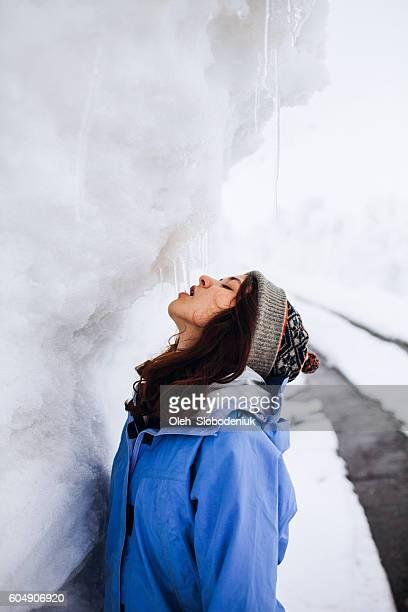 Girl eats icicle