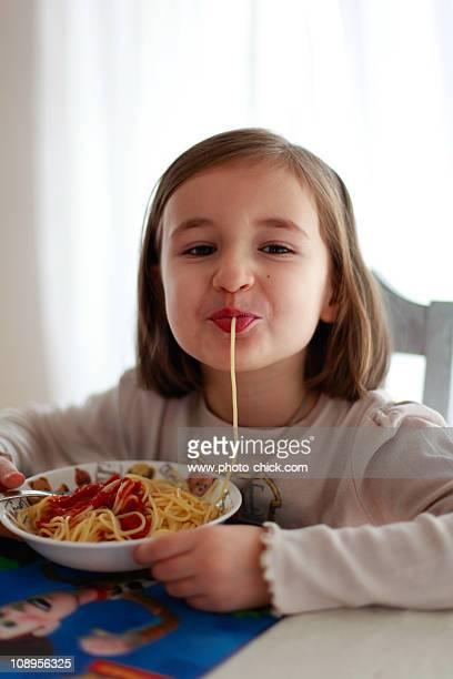 Girl eats spaghetti