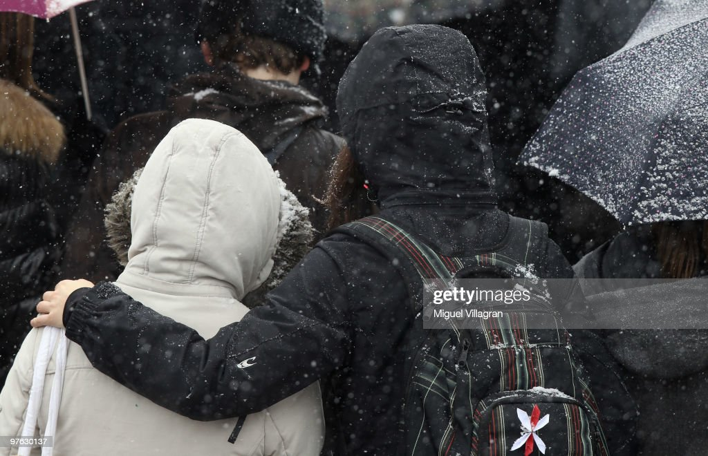 A girl embraces another girl during the commemoration ceremony in front of the Albertville School on March 11 2010 in Winnenden Germany Tim...