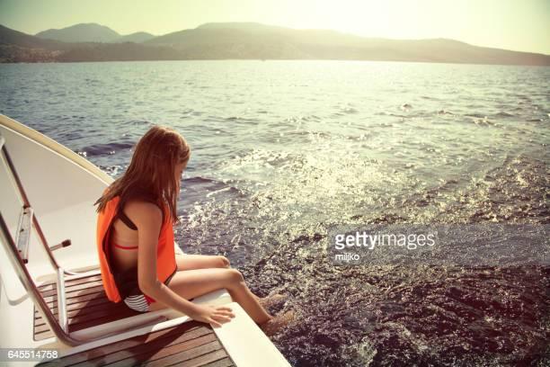 Girl enjoying her vacation on sailboat