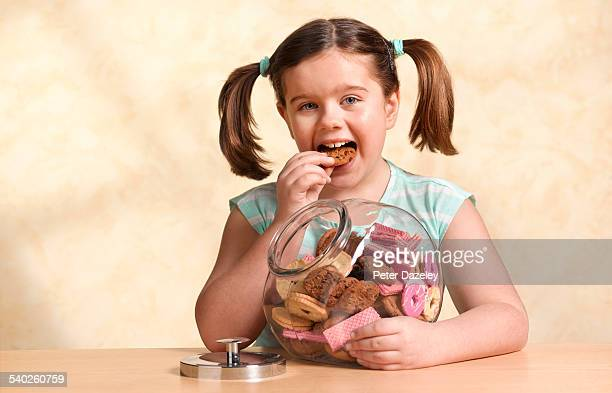 Girl enjoying jar of cookies