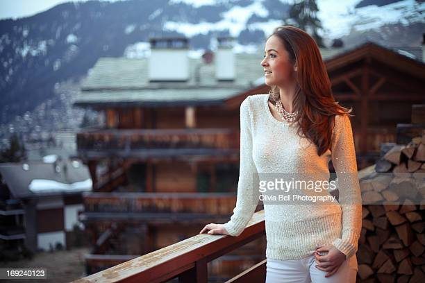 Girl enjoying life on balcony in Swiss Alps