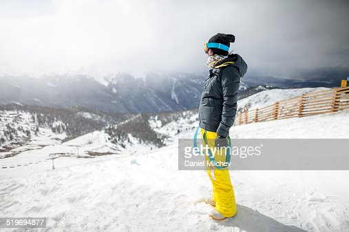 Girl enjoying mountain scenery during the winter.