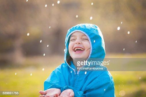 Girl (4-5) enjoying rain