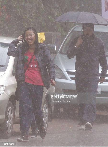 A girl enjoying rainfall on January 17 2013 in New Delhi India Capital witnessed light rain and chilly winds even though temperatures were above...
