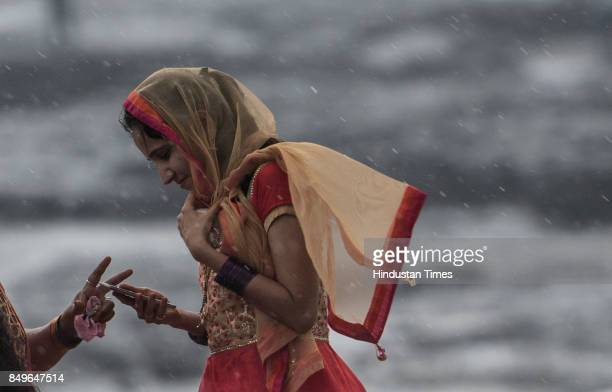 A girl enjoys rain at Bandra Bandstand on September 19 2017 in Mumbai India Heavy rains were recorded in many areas leading to traffic jams and...