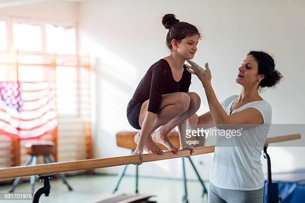 Girl Exercise On Gymnastics Bar.