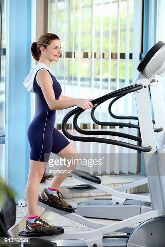 Girl exercising in a fitness center.