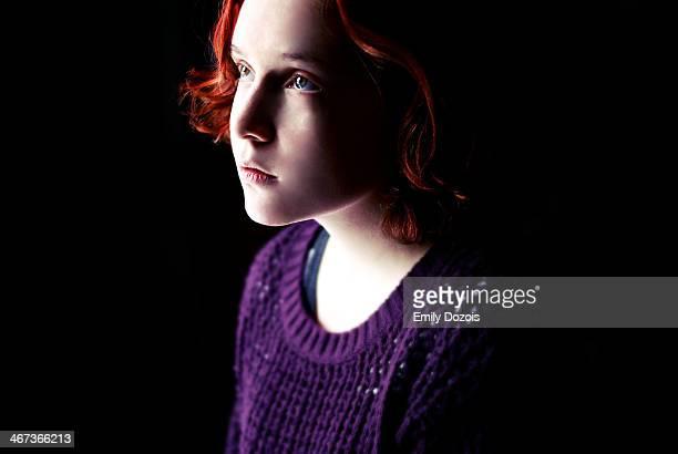 Girl facing a light on a dark background