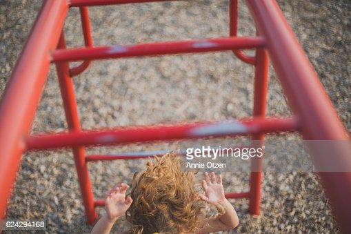 Girl Falling From Monkey Bars
