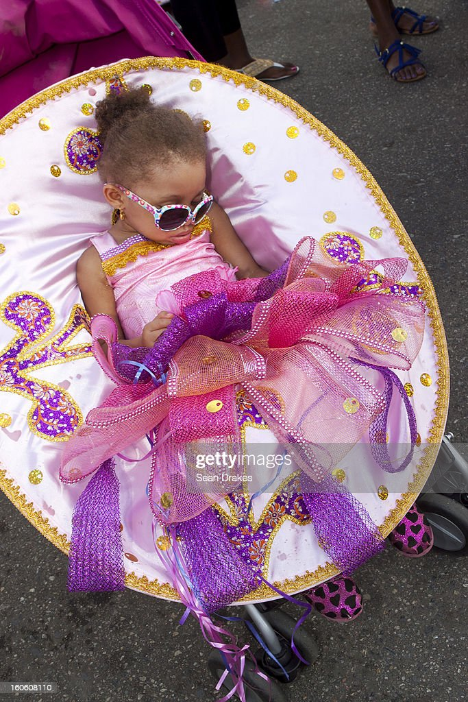 A girl falls asleep during the Red Cross Children's Carnival at Queen's Park Savannah on February 02, 2013 in Port of Spain, Trinidad.