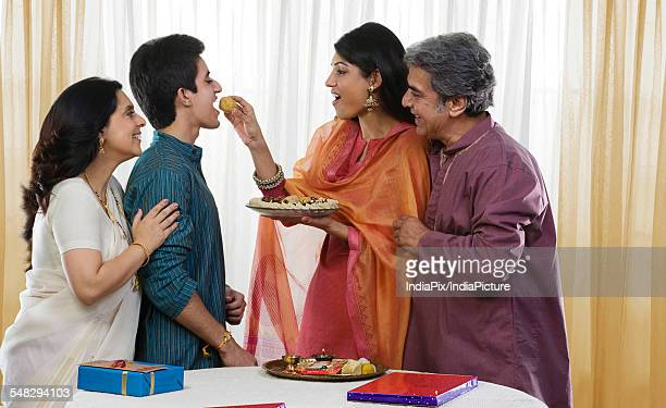 Girl feeding her brother during Rakhi