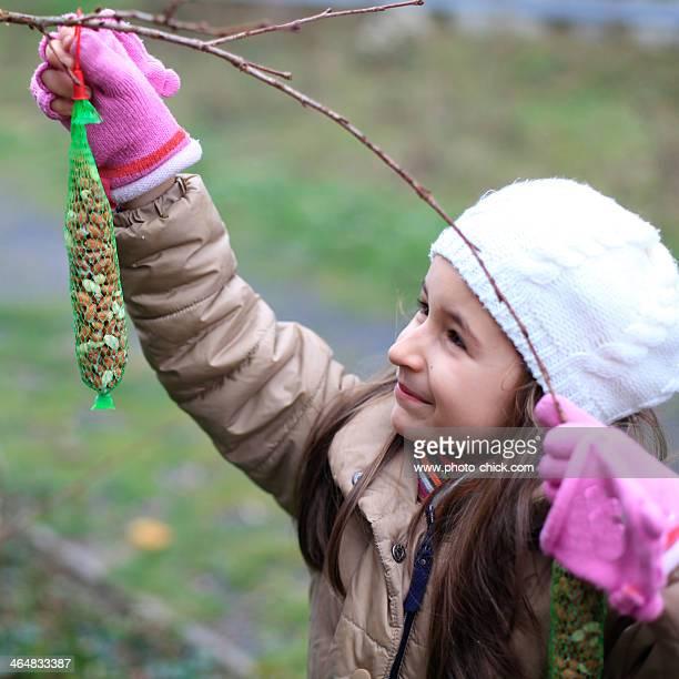 girl feeding the birds