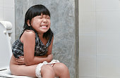Asian girl feel pain with constipation in the bathroom, Healthy concept