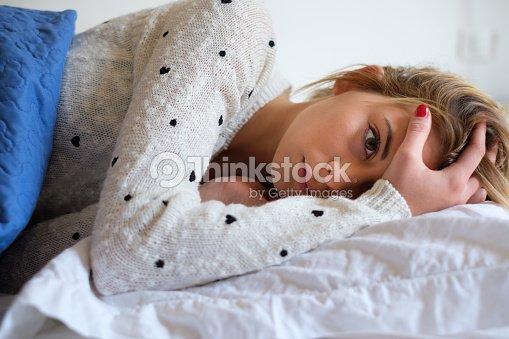 Girl feeling bad and trying to sleep : Stock Photo