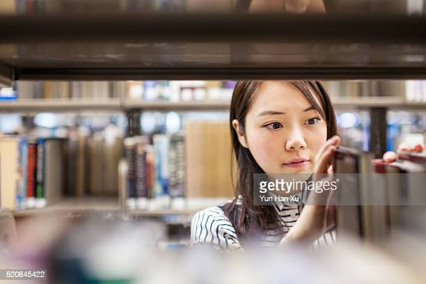 Girl Finding a Book in Library