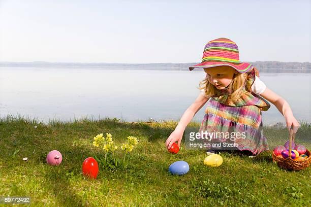 girl finding easter eggs