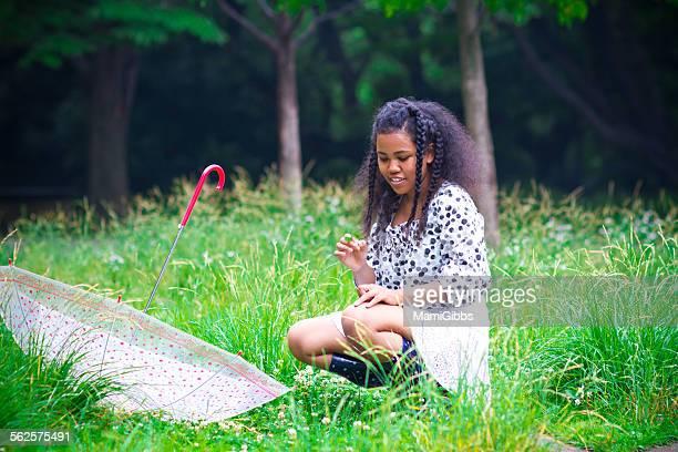 Girl finds a rare four-leaf  clover