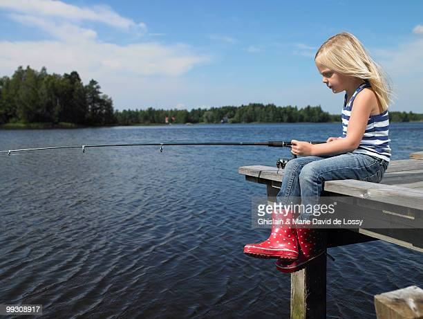 Girl fishing from a dock