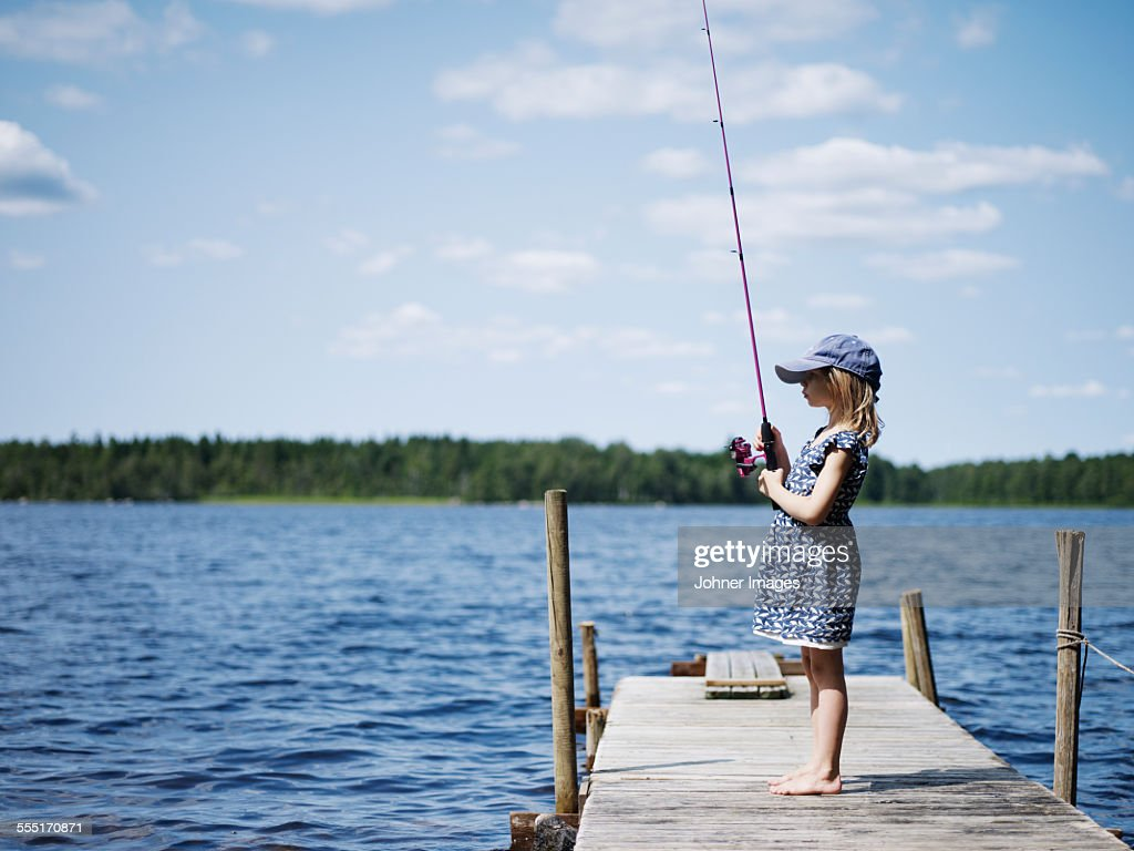 Girl fishing on jetty